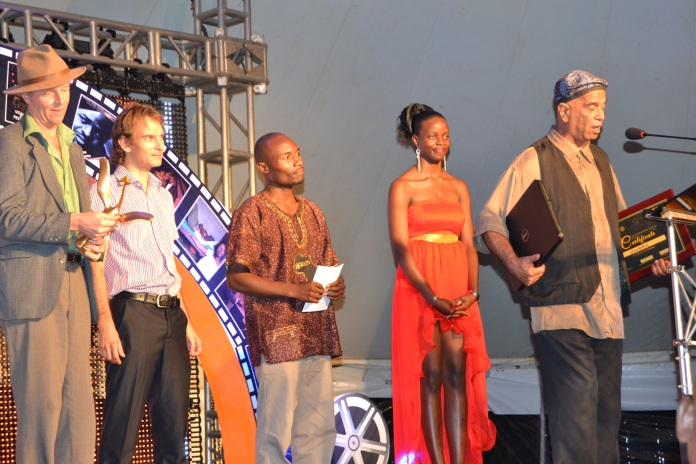 Zanzibari filmmaker, Shams Bhanji (R) is joined on stage by some of the cast and crew for his film 'Zamora' as he accepts the award for Best Sound.